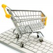 Royalty-Free Stock Photo: Shopping cart and computer keyboard