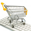 Shopping cart and computer keyboard — Stock Photo
