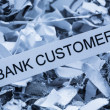 Stock Photo: Scraps bank customer
