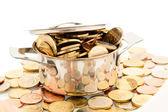 Saucepan and euro coins — Stock Photo