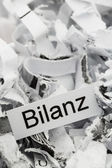 Shredded paper keyword balance — Stock Photo