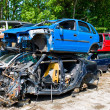 Junk cars in a junkyard - Stock Photo