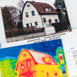 Stock Photo: Save energy. house with thermal imaging camera