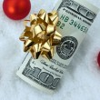 U.s. dollar bills with a bow as a gift of money — Foto Stock