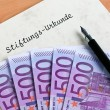 Euro notes and a foundation certificate - Stock Photo
