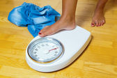 Feet on a bathroom scale — Stock Photo