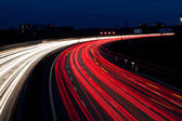 Cars on freeway at night — Stock Photo