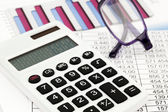 Calculator and figures — Stock Photo
