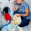 Housewife with washing machine — Stockfoto #19692131