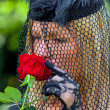 Widow with veil and rose — Stock Photo #19692195