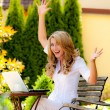 Stock Photo: Successful, laughing womwith laptop in garden