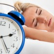 Clock with sleepless at night. - Stock Photo