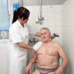 Senior is bathed by nurses — Stock Photo #19693465