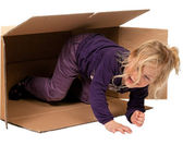 Child in moving box. if moving to box. — Stock Photo