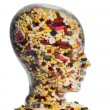 Stock Photo: Head made of glass with tablets