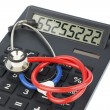 Stethoscope and calculator - Stock Photo