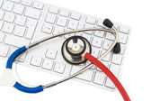 Stethoscope and keyboard of a computer — Stock Photo