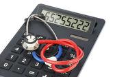 Stethoscope and calculator — Stock Photo