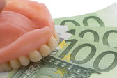 Dentition and euro notes — Stock Photo