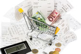 Cart, receipts and money — Stock Photo