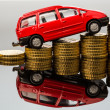 Rising car costs. car on coins — Stockfoto