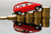 Rising car costs. car on coins — Stock Photo