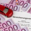 Stock Photo: Insurance contract for a new car