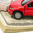 Stock Photo: Car on dollar bills
