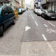 Cyclists and one-way street — Stock Photo