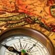 Old compass with map - Stock Photo