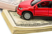 Car on dollar bills — Stock Photo