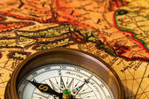 Old compass with map — Stock Photo
