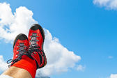Walking shoes with hiking in the mountains — Stock Photo