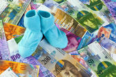 Children socks with swiss franc banknotes — Stock Photo