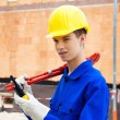 Apprentice / trainee. construction worker on construction site w — Stock Photo