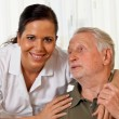 Nurse in elderly care for the elderly in nursing homes - Stock Photo