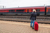 Woman waits for her train station — Stok fotoğraf