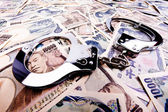 Yen bills, currency from japan and handcuffs — Stock Photo