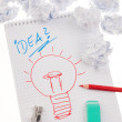 Incident and idea with bulb. symbol on a drawing. - Stock Photo