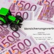 Stock Photo: Insurance contract for new tractor