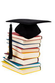 Mortarboard on books stack — Stock Photo