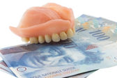 Dentition and swiss franc — Stock Photo