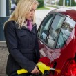 Woman at gas station to refuel — Stock Photo #23286482