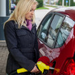 Woman at gas station to refuel — Stock Photo