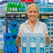 Royalty-Free Stock Photo: Woman buys bottled water at the grocery store
