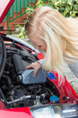 Woman charged after oil in car — Stock Photo