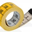 Yellow tape measure - Stock Photo