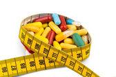 Comprimidos e fita métrica — Foto Stock