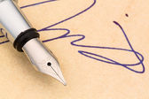 Signature and pen — Stock Photo