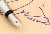 Signature and pen — Stock Photo